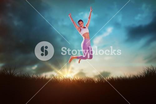Composite image of sporty blonde jumping with arms out
