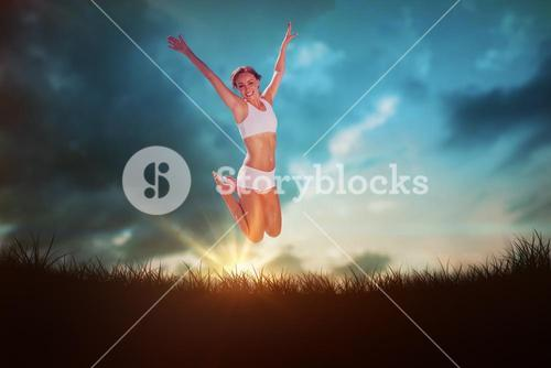 Composite image of gorgeous fit blonde jumping with arms out