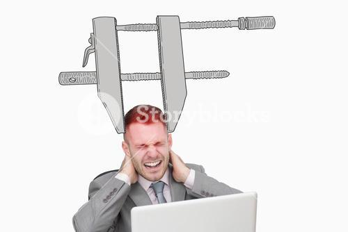 Composite image of business man suffering from severe neck pain while using laptop