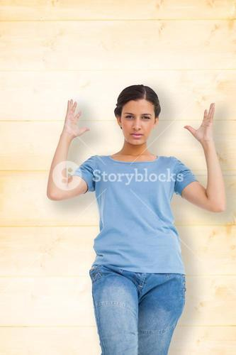 Composite image of annoyed brunette gesturing
