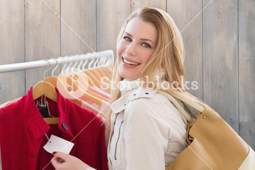 Composite image of blonde shopping