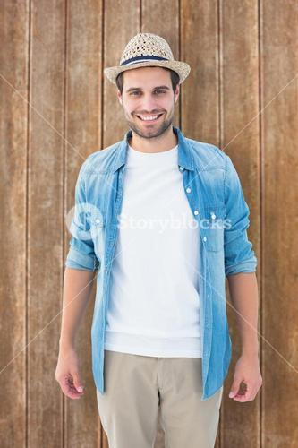 Composite image of handsome hipster smiling at camera