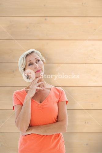Composite image of thinking older woman with arms crossed