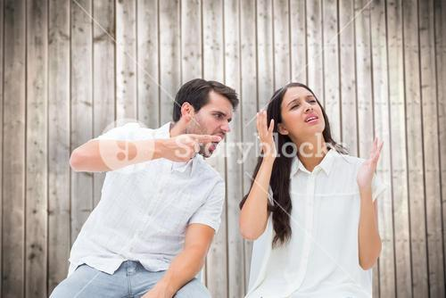 Composite image of couple sitting on chairs arguing