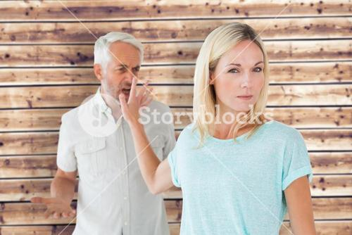 Composite image of woman not listening to her angry partner