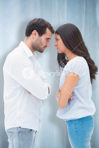 Composite image of angry couple facing off after argument