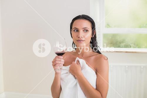 Pretty brunette drinking red wine