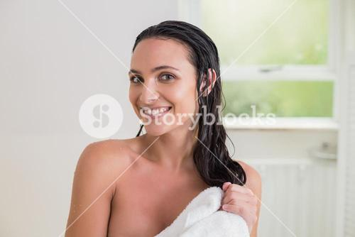Pretty brunette wiping her hair