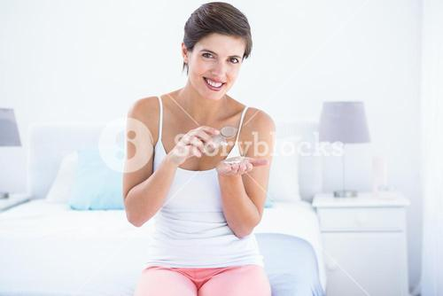 Attractive woman taking pills