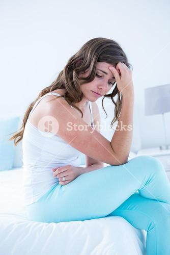Attractive woman with stomach pain
