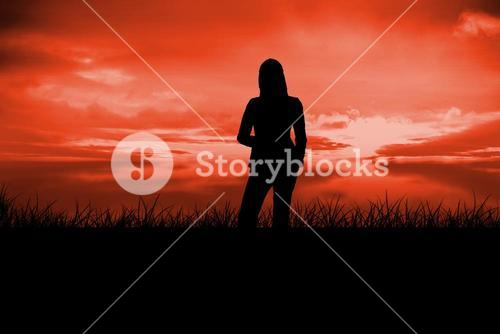 Composite image of silhouette of businesswoman standing