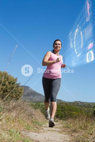 Composite image of active woman jogging in the countryside