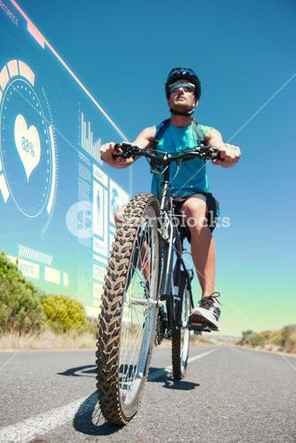 Composite image of athletic man cycling on open road