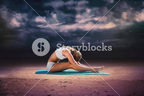 Composite image of gorgeous fit blonde in seated forward bend pose