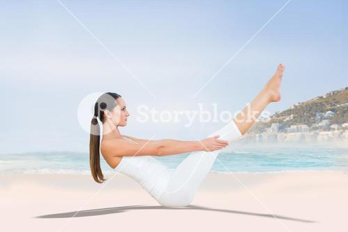 Composite image of toned woman doing the boat pose in the beach