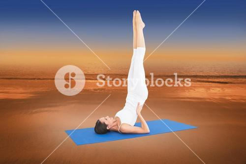 Composite image of fit woman stretching body in fitness studio