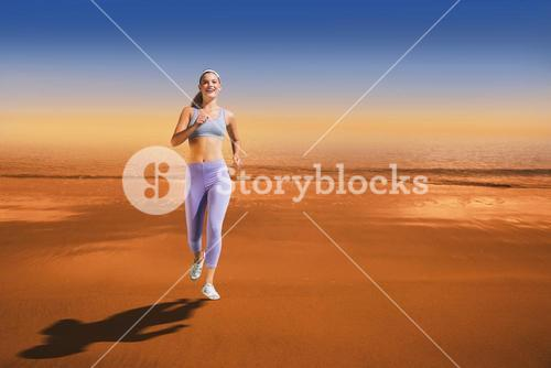 Composite image of sporty blonde jogging towards camera