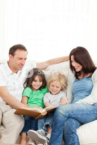 Cheerful family looking at a photo album together