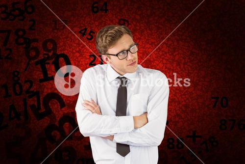 Composite image of young businessman thinking with arms crossed