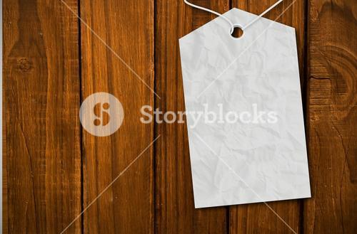Composite image of crumpled paper tag