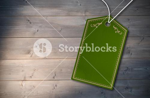 Composite image of elegant green and gold tag
