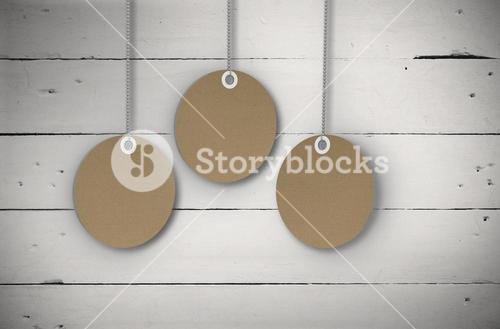 Composite image of circle tag hanging