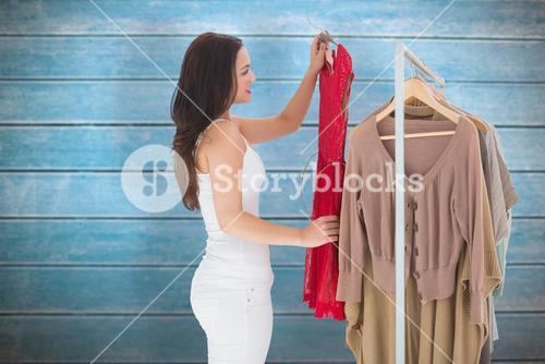 Composite image of woman choosing clothes