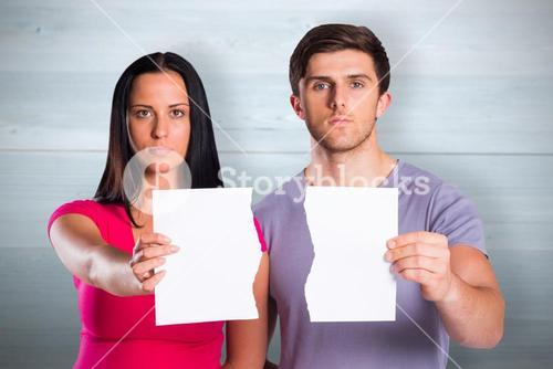 Composite image of couple showing broken piece of paper