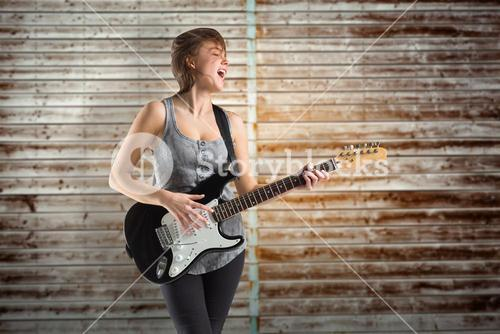 Composite image of pretty young girl playing guitar