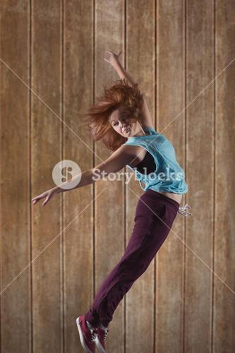 Composite image of pretty break dancer