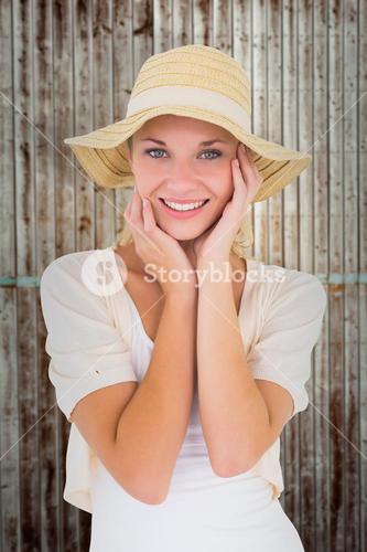 Composite image of attractive young blonde smiling at camera in sunhat