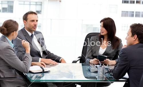 Charismatic businessman talking to his partners during a meeting