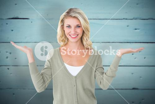 Composite image of pretty young blonde holding hands out