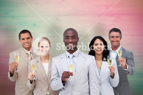 Composite image of smiling business team celebrating an event