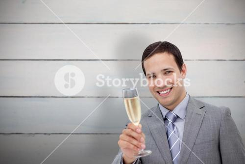 Composite image of businessman toasting with champagne