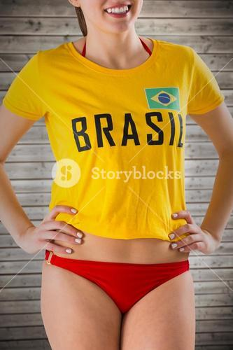 Composite image of pretty girl in bikini and brasil tshirt
