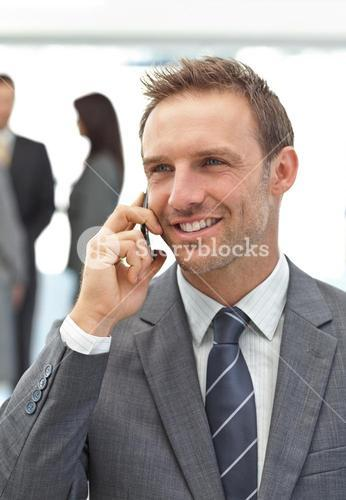 Successful businessman on the phone during a meeting