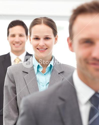 Happy businesswoman standing in a row with her two partners