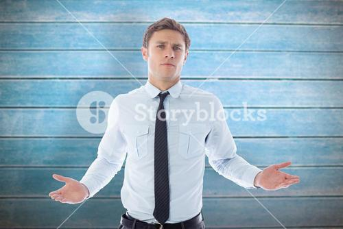 Composite image of puzzled businessman