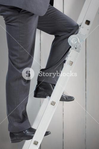 Composite image of businessman climbing up ladder