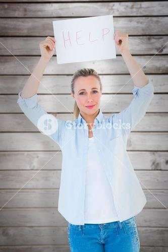Composite image of pretty blonde holding help sign