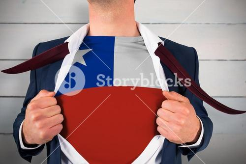 Composite image of businessman opening shirt to reveal chile flag