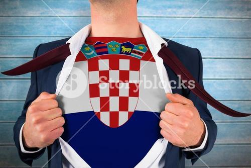 Composite image of businessman opening shirt to reveal croatia flag