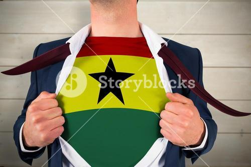 Composite image of businessman opening shirt to reveal ghana flag