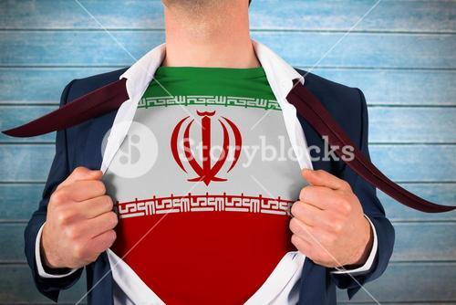 Composite image of businessman opening shirt to reveal iran flag