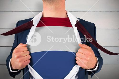 Composite image of businessman opening shirt to reveal netherlands flag