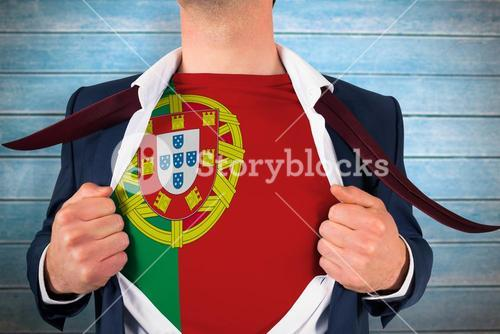 Composite image of businessman opening shirt to reveal portugal flag