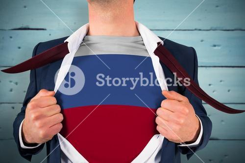 Composite image of businessman opening shirt to reveal russia flag