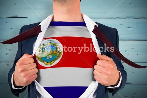 Composite image of businessman opening shirt to reveal costa rica flag