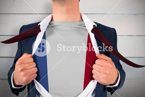 Composite image of businessman opening shirt to reveal france flag